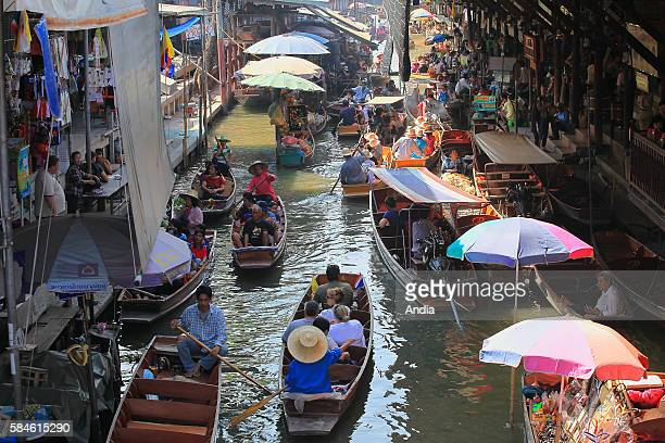 Damnoen Saduak floating market is one of the main tourist attractions around Bangkok in Thailand
