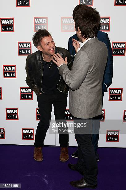 Damon Albarn and Noel Gallagher are seen in the press room at the Brit Awards 2013 at the 02 Arena on February 20 2013 in London England