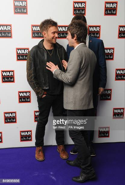 Damon Albarn and Noel Gallagher in the press room at the 2013 Brit Awards at the O2 Arena London