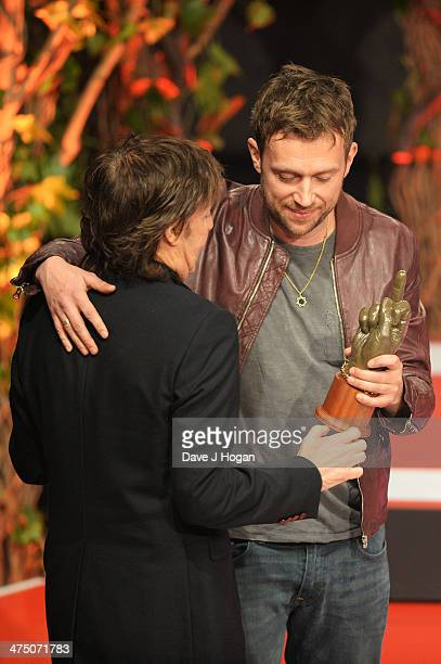 Damon Albarn and Sir Paul McCartney onstage at the annual NME Awards at Brixton Academy on February 26 2014 in London England