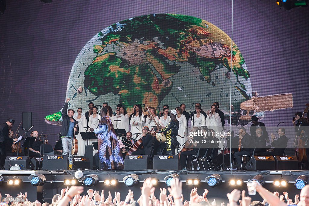 <a gi-track='captionPersonalityLinkClicked' href=/galleries/search?phrase=Damon+Albarn&family=editorial&specificpeople=207168 ng-click='$event.stopPropagation()'>Damon Albarn</a> and The Orchestra of Syrian Musicians performs at Roskilde Festival on June 29, 2016 in Roskilde, Denmark.