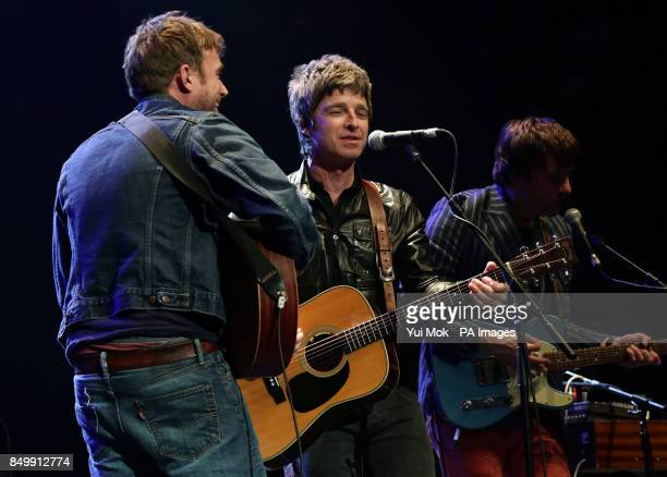 Damon Albarn Noel Gallagher and Graham Coxon performing on stage during their Teenage Cancer Trust gig at the Royal Albert Hall in London
