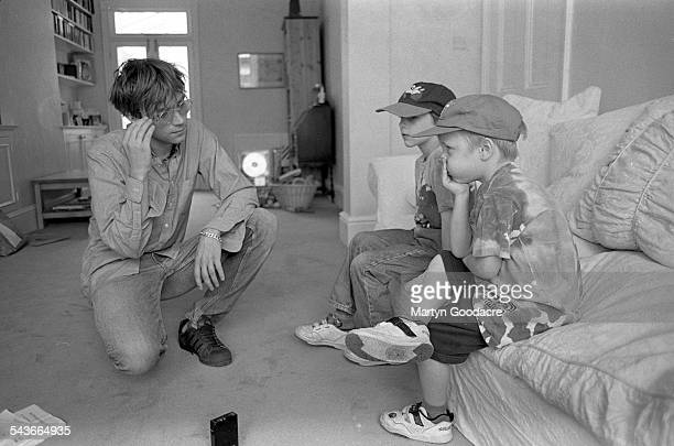 Damon Albarn of Blur with record producer Stephen Street's children at Street's house London United Kingdom 1995