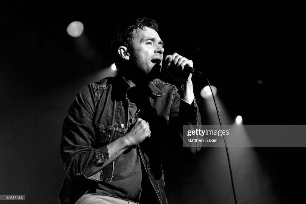 This image was converted to black and white) Damon Albarn performs on the Obelisk Arena stage at the Latitude Festival at Henham Park Estate on July 19, 2014 in Southwold, England.