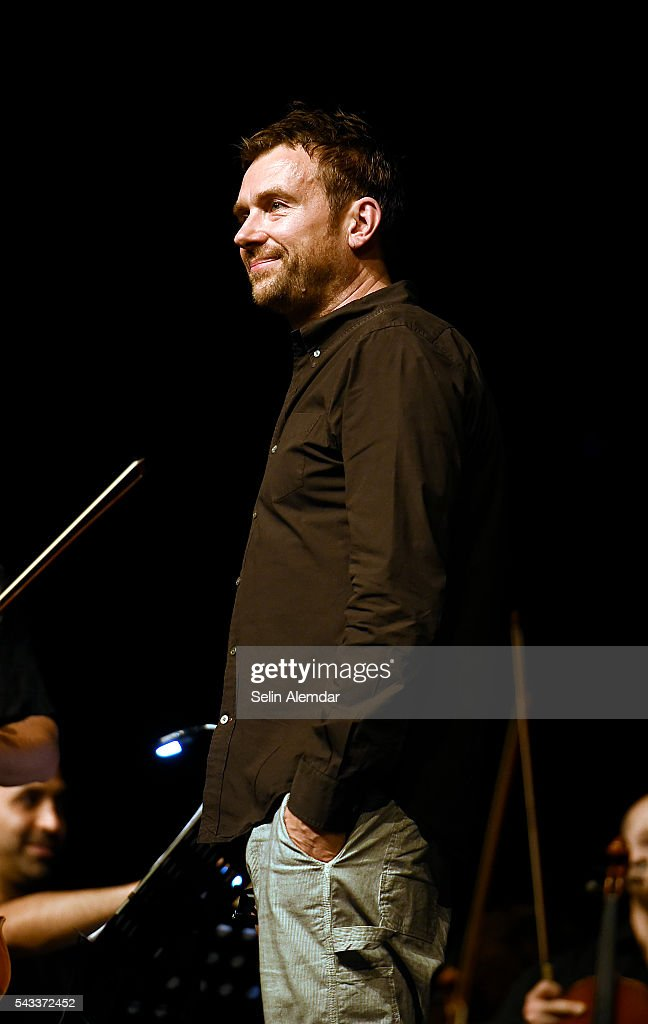 <a gi-track='captionPersonalityLinkClicked' href=/galleries/search?phrase=Damon+Albarn&family=editorial&specificpeople=207168 ng-click='$event.stopPropagation()'>Damon Albarn</a> performs with The Orchestra of Syrian Musicians at the 23th Istanbul Jazz Festival at Cemil Topuzlu Open Air Theatre on June 27, 2016 in Istanbul, Turkey.