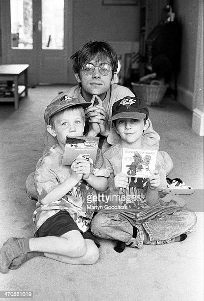 Damon Albarn poses with record producer Stephen Street's children at Street's house London United Kingdom 1995