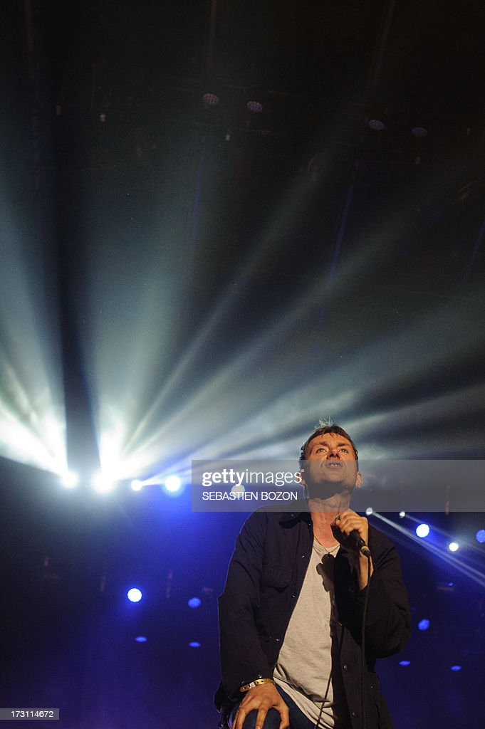 Damon Albarn, singer of British band Blur, performs on July 7, 2013 at the Eurockeennes festival in the eastern French city of Belfort. AFP PHOTO/SEBASTIEN BOZON