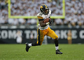 Damon Bullock of the Iowa Hawkeyes runs for the gamewinning touchdown against the Northern Illinois Huskies at Soldier Field on September 1 2012 in...