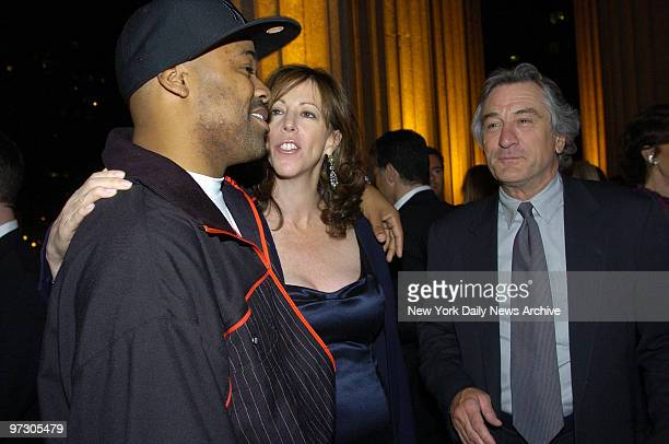 Damon Dash talks with Jane Rosenthal and Robert De Niro at a Vanity Fair party celebrating the fourth annual Tribeca Film Festival at the State...