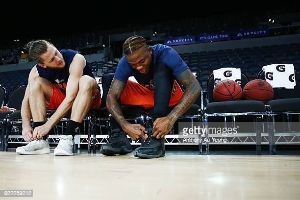 Damon Heuir and Fuquan Edwin of the Taipans tie their shoes during warm up prior to the round six NBL match between the New Zealand Breakers and the...