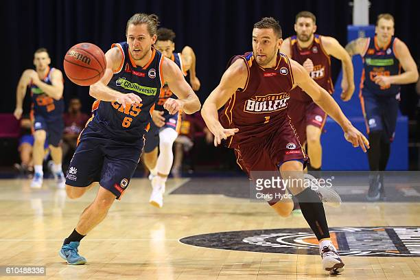 Damon Heuir of the Taipans tand Adam Gibson of the Bullets compete for the ball during the Australian Basketball Challenge match between Brisbane...