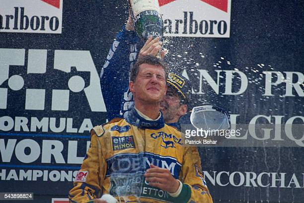 Damon Hill douses Michael Schumacher with champagne on the podium after Damon Hill won the Belgium Grand Prix Michael Schumacher came in second