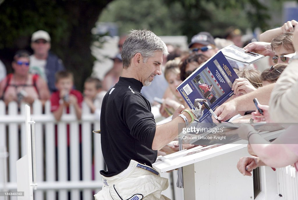 <a gi-track='captionPersonalityLinkClicked' href=/galleries/search?phrase=Damon+Hill&family=editorial&specificpeople=195346 ng-click='$event.stopPropagation()'>Damon Hill</a>, F1 champion in 1997, signs autographs at the 2005 Goodwood Festival of Speed on June 25, 2005.