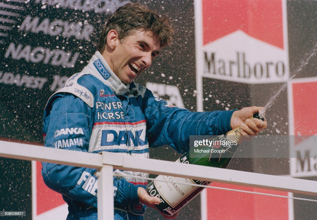 <a gi-track='captionPersonalityLinkClicked' href=/galleries/search?phrase=Damon+Hill&family=editorial&specificpeople=195346 ng-click='$event.stopPropagation()'>Damon Hill</a> of Great Britain and driver of the #1 Danka Arrows Yamaha Arrows A18 Yamaha 0X11A V10 sprays champagne to celebrate his second place at the Hungarian Grand Prix on 10th August 1997 at the Hungaroring Circuit, Budapest, Hungary.