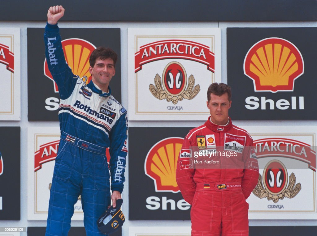 <a gi-track='captionPersonalityLinkClicked' href=/galleries/search?phrase=Damon+Hill&family=editorial&specificpeople=195346 ng-click='$event.stopPropagation()'>Damon Hill</a> of Great Britain, driver of the #5 Rothmans Williams Renault Williams FW18 Renault RS8 V10 celebrates over <a gi-track='captionPersonalityLinkClicked' href=/galleries/search?phrase=Michael+Schumacher&family=editorial&specificpeople=157602 ng-click='$event.stopPropagation()'>Michael Schumacher</a> after winning the Brazilian Grand Prix on 31st March 1996 at the Autodromo Jose Carlos Pace, Interlagos, Brazil.