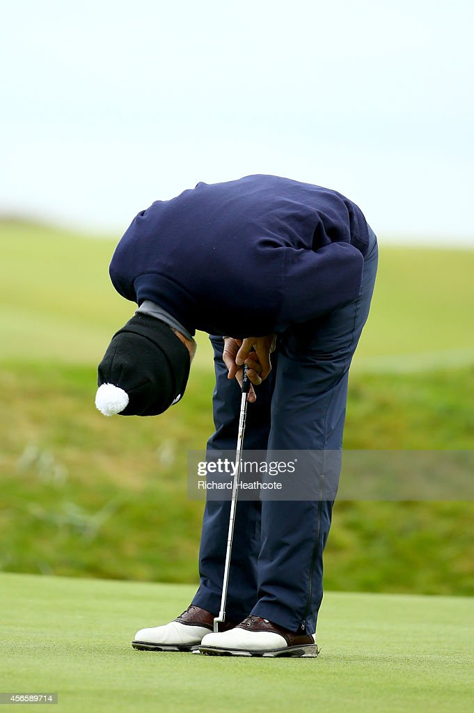 <a gi-track='captionPersonalityLinkClicked' href=/galleries/search?phrase=Damon+Hill&family=editorial&specificpeople=195346 ng-click='$event.stopPropagation()'>Damon Hill</a> reacts after missing his putt on the 16th hole during the second round of the 2014 Alfred Dunhill Links Championship at the Championship Links at Carnoustie on October 3, 2014 in Carnoustie, Scotland.