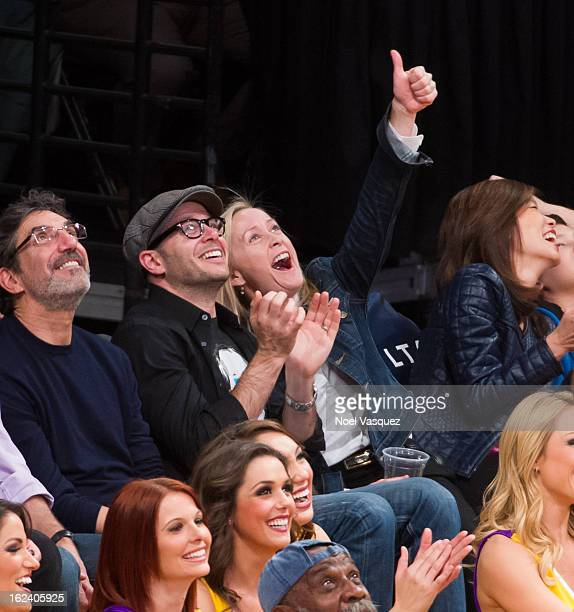 Damon Lindelof and his wife Heidi Fugeman attend a basketball game between the Portland Trailblazers and the Los Angeles Lakers at Staples Center on...
