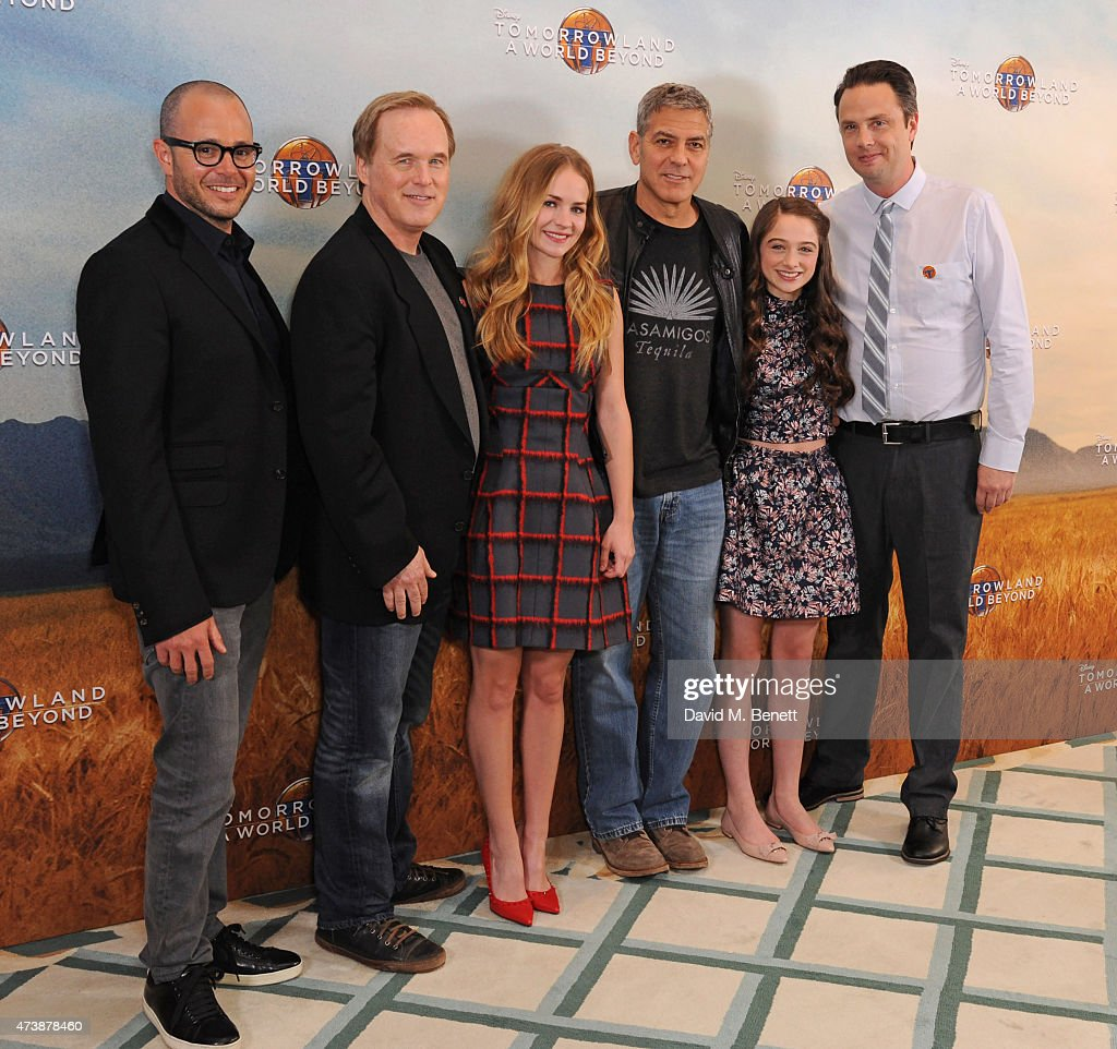 Damon Lindelof, Brad Bird, Britt Robertson, George Clooney, Raffey Cassidy and Jeff Jensen pose at a photocall for 'Tomorrowland' at Claridge's Hotel on May 18, 2015 in London, England.