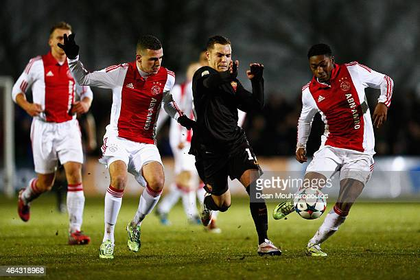 Damon Mirani and Shaquill Sno of Ajax battle for the ball with Riccardo Marchizza of Roma during the UEFA Youth League Round of 16 match between Ajax...