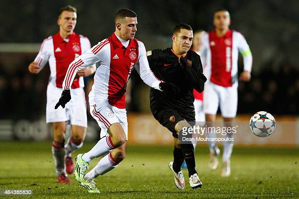 Damon Mirani of Ajax battles for the ball with Riccardo Marchizza of Roma during the UEFA Youth League Round of 16 match between Ajax Amsterdam and...