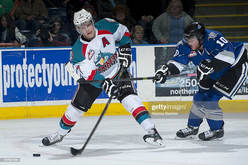 Damon Severson of the Kelowna Rockets is checked by Ben Walker of the Victoria Royals on February 8 2014 at Prospera Place in Kelowna British...