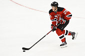 Damon Severson of the New Jersey Devils in action during a game against the San Jose Sharks at the Prudential Center on October 18 2014 in Newark New...