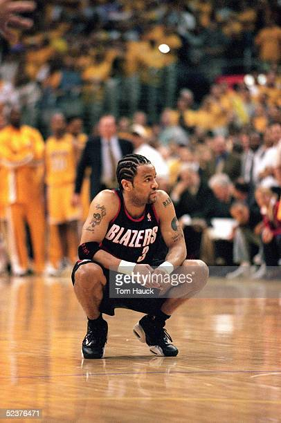 Damon Stoudamire of the Portland Trail Blazers kneels on the court during Game 7 of the Western Conference Finals against the Los Angeles Lakers at...