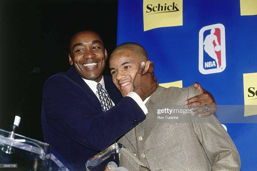 Damon Stoudamire of the Toronto Raptors poses for a portrait with Isiah Thomas during the Rookie of the Year press conference on May 15 1996 in...
