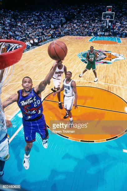 Damon Stoudamire of the Toronto Raptors shoots during the 1996 Rookie Challenge played February 10 1996 at the Alamodome in San Antonio Texas NOTE TO...