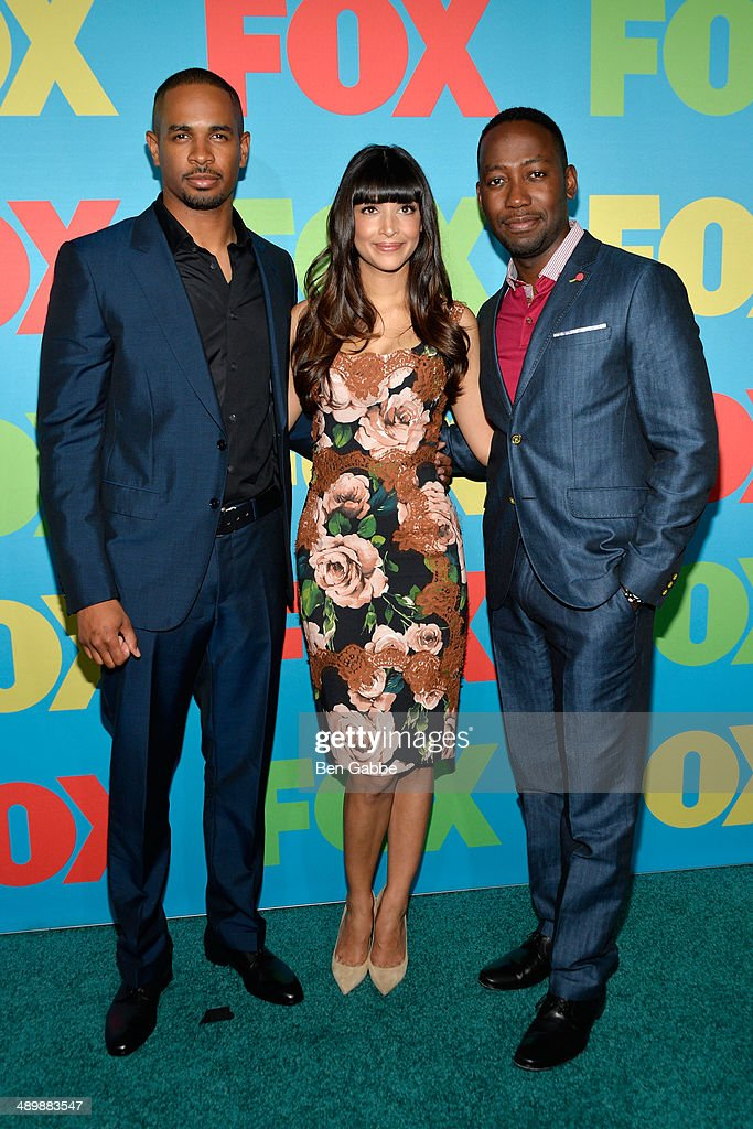 Damon Wayans Jr., Hannah Simone and Lamorne Morris attend the FOX 2014 Programming Presentation at the FOX Fanfront on May 12, 2014 in New York City.