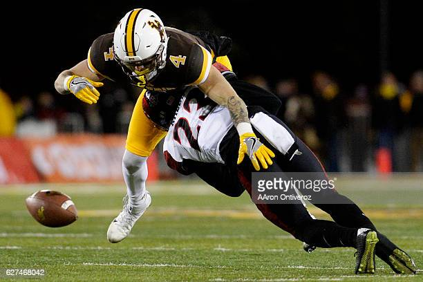 Damontae Kazee of the San Diego State Aztecs breaks up a pass intended for Cooper Rothe of the Wyoming Cowboys during the first quarter of play on...