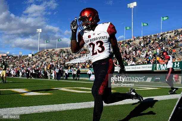 Damontae Kazee of the San Diego State Aztecs celebrates his picksix on Nick Stevens of the Colorado State Rams during the third quarter of play The...