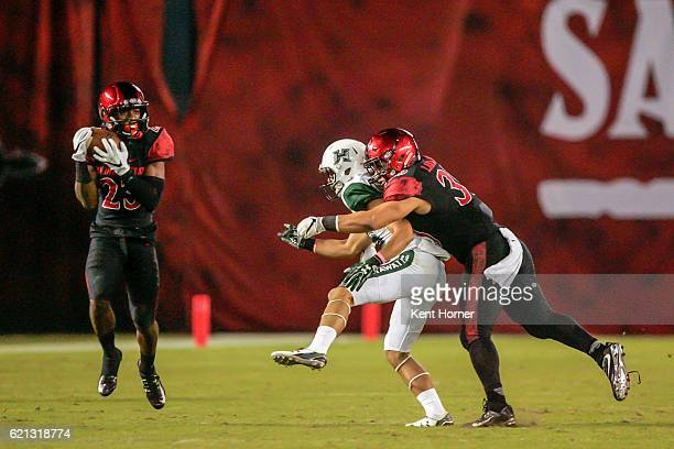 Damontae Kazee of the San Diego State Aztecs intercepts the ball in the second half after John Ursua of the Hawaii Rainbows is unable to catch a pass...