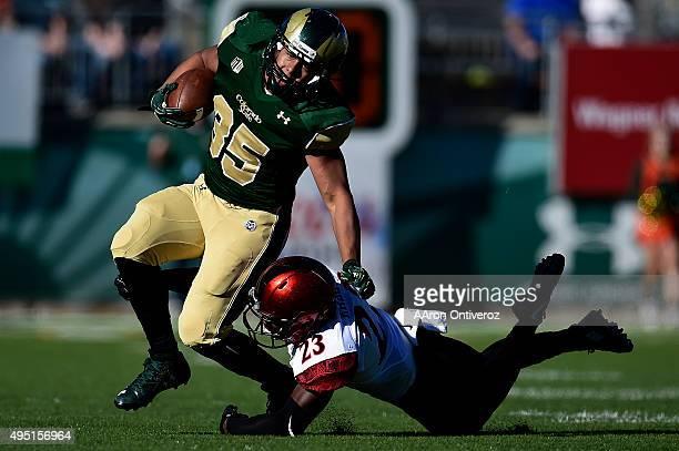 Damontae Kazee of the San Diego State Aztecs tackles Izzy Matthews of the Colorado State Rams during the first half of play The Colorado State Rams...