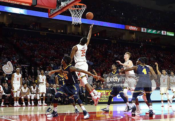 Damonte Dodd of Maryland taps in a basket during an NCAA basketball game on November 17 2016 at Xfinity Center in College Park MD Maryland defeated...