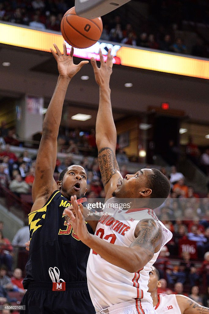 Damonte Dodd #35 of the Maryland Terrapins puts up a shot over the defense of Amir Williams #23 of the Ohio State Buckeyes in the first half on December 4, 2013 at Value City Arena in Columbus, Ohio. Ohio State defeated Maryland 76-60.