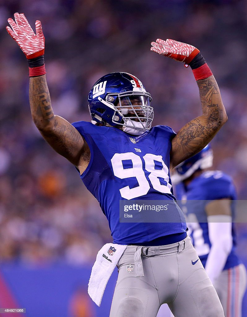 <a gi-track='captionPersonalityLinkClicked' href=/galleries/search?phrase=Damontre+Moore&family=editorial&specificpeople=8318058 ng-click='$event.stopPropagation()'>Damontre Moore</a> #98 of the New York Giants celebrates after he sacked Jeff Tuel of the Jacksonville Jaguars in the second half of preseason action at MetLife Stadium on August 22, 2015 in East Rutherford, New Jersey.