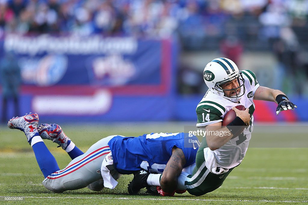 <a gi-track='captionPersonalityLinkClicked' href=/galleries/search?phrase=Damontre+Moore&family=editorial&specificpeople=8318058 ng-click='$event.stopPropagation()'>Damontre Moore</a> #98 of the New York Giants tackles <a gi-track='captionPersonalityLinkClicked' href=/galleries/search?phrase=Ryan+Fitzpatrick&family=editorial&specificpeople=622098 ng-click='$event.stopPropagation()'>Ryan Fitzpatrick</a> #14 of the New York Jets at MetLife Stadium on December 6, 2015 in East Rutherford, New Jersey.