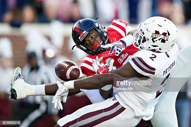 Damore'ea Stringfellow Jr #3 of the Mississippi Rebels has a pass knocked away in the first half by Jamal Peters of the Mississippi State Bulldogs at...