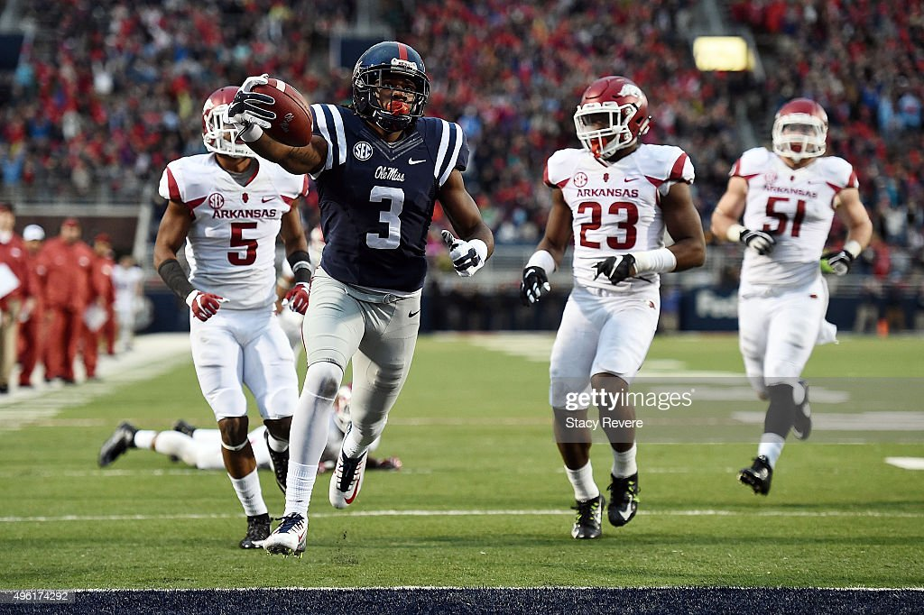 Damore'ea Stringfellow of the Mississippi Rebels scores a touchdown during the third quarter of a game against the Arkansas Razorbacks at...