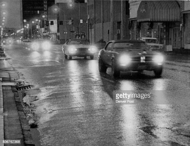 Damp Downtown Earlymorning traffic moves along snow and raindampened 15th Street near California Street in downtown Denver Friday National Weather...
