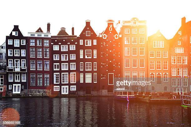 Damrak canal sunset in Amsterdam, Netherlands