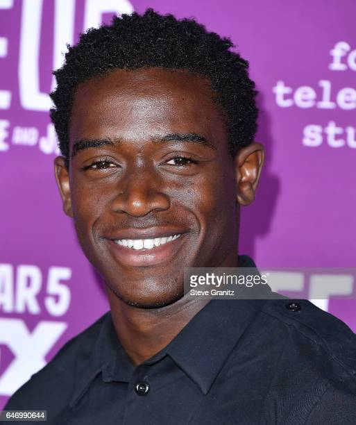 Damson Idris arrives at the Premiere Of FX Network's 'Feud Bette And Joan' at Grauman's Chinese Theatre on March 1 2017 in Hollywood California