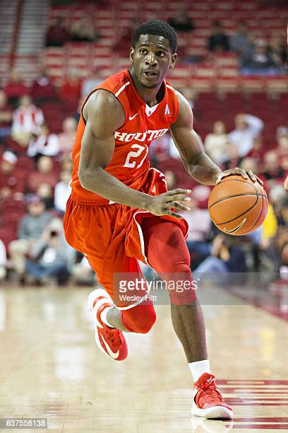 Damyean Dotson of the Houston Cougars dribbles down the court during a game against the Arkansas Razorbacks at Bud Walton Arena on December 6 2016 in...