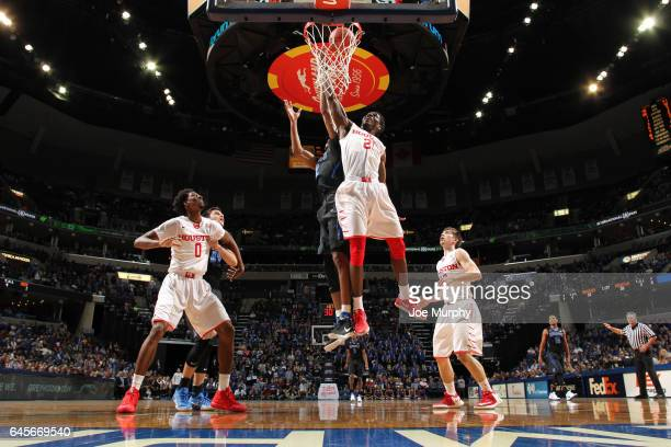 Damyean Dotson of the Houston Cougars jumps for a rebound against the Memphis Tigers on February 26 2017 at FedExForum in Memphis Tennessee Houston...
