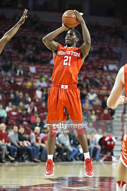 Damyean Dotson of the Houston Cougars shoots a jump shot during a game against the Arkansas Razorbacks at Bud Walton Arena on December 6 2016 in...