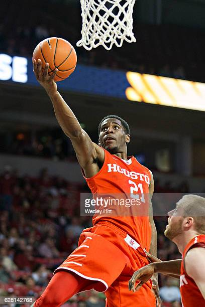 Damyean Dotson of the Houston Cougars shoots a lay up during a game against the Arkansas Razorbacks at Bud Walton Arena on December 6 2016 in...