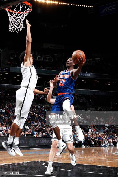 Damyean Dotson of the New York Knicks goes to the basket against the Brooklyn Nets during a preseason game on October 8 2017 at Barclays Center in...