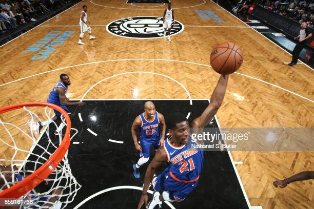Damyean Dotson of the New York Knicks grabs the rebound against the Brooklyn Nets during a preseason game on October 8 2017 at Barclays Center in...