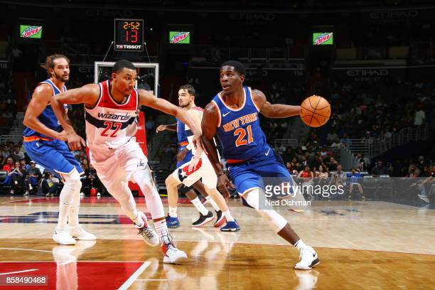 Damyean Dotson of the New York Knicks handles the ball against Otto Porter Jr #22 of the Washington Wizards during the preseason game on October 6...